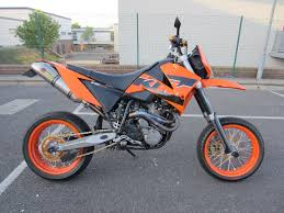 ktm lc4 640 supermoto 2005 in orange with full akrapovic exhaust