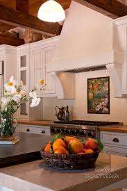 Mediterranean Kitchen Tiles - spanish tile backsplash kitchen eclectic with kohler cast iron