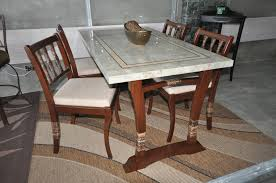 marble top dining table and wooden chairs villa verde collection