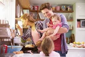 family cooking meal in kitchen together stock photo picture and
