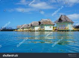 tropical eco resort thatched overwater bungalows stock photo