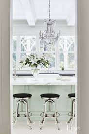 933 best images about luxe 2 on pinterest splash of color the kitchen s dark floors were painted white and the island s butcher block top was