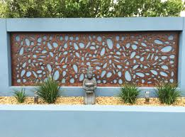 decorative wood screen used to decorate a concrete fence wall