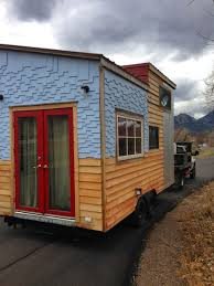 a 159 square feet tiny house on wheels clad in various siding