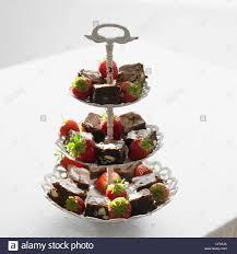 white decorative metal three tier cake stand small square slices