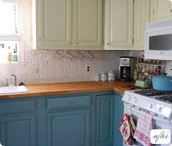 paint ikea cabinets one exle of kitchen cabinets painted in two colors that i like