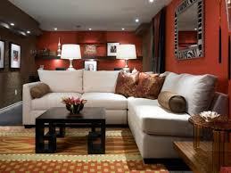 orange wall color with white l shaped sectional sofa for amazing