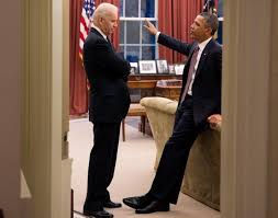 president barack obama and vice president joe biden in the oval
