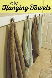 Bathroom Towels Ideas by Hanging Towel On Bar