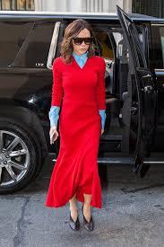 wearing a red sweater dress over a blue button down shirt