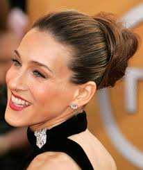 hair in a bun for women over 50 long hairstyles over 50 high bun hairstyle for women over 50