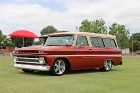 first chevy suburban covering classic cars summer tailgate photo shoot with a 1965