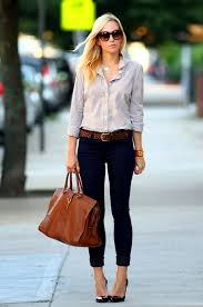 how to wear an orange pendant with navy and white skinny jeans