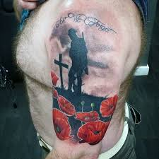 stunning colored world war memorial shoulder tattoo with flowers