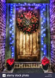 lighted christmas wreath lighted christmas wreath on wood door with blue light trim stock