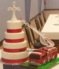 4 tier white fondant wedding cake with silver pearls red ribbons