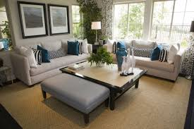 rug under coffee table choosing the right sized area rug for your space the star