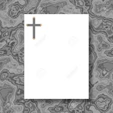white writing paper with cross in header lying on gray marble