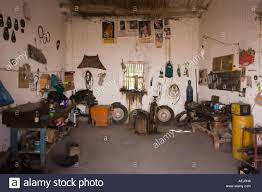 a small car repairing workshop garage taller mecánico in a middle