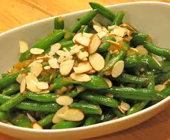 green beans mixed with a miso dressing and almonds realistic