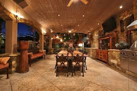 mediterranean porch with exterior tile floors outdoor kitchen in