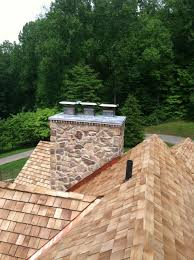 Outdoor Fireplace Caps by Beautiful Cedar Roof Stone Chimney With A Custom Made Lead