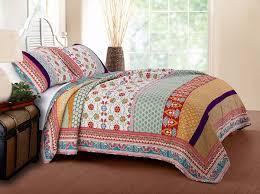 bedroom king size quilt sets with brown wooden floor and orange