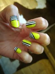 non symmetrical design with straight lines nail art