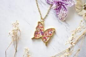 flowers with butterfly necklace images Real dried flowers and resin butterfly necklace in gold purple jpg