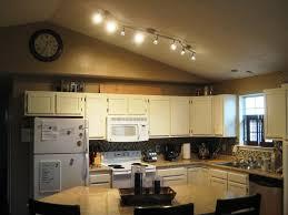 kitchen galley kitchen track lighting serveware microwaves