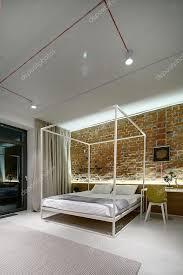Loft Style Bed Frame Bedroom In A Modern Loft Style Brick Wall Without Plaster Bed