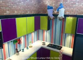 kuala lumpur s upside down house is here kualalumpurkids not sure we pulled this one off but it does vaguely look like my two are coming down from the ceiling maybe