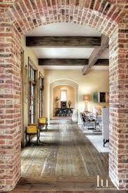 traditional neutral hallway with arched brick entry luxe halls