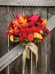 10 fall door decorations that aren t wreaths hgtv s decorating garden rake welcome