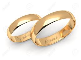 wedding rings together gold wedding rings engraved with the text forever together stock