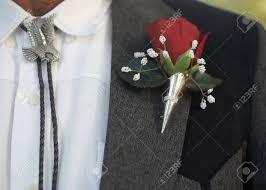 Wedding Boutonniere Bolo Tie With Classic Red Rose Wedding Boutonniere Stock Photo