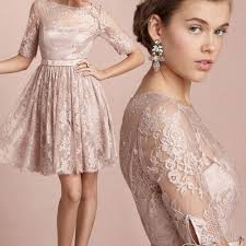 knee length lace wedding dress features v cut neckline and keyhole