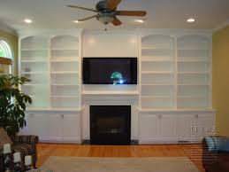 arch face top base cabinets crown moulding bookcases frame the