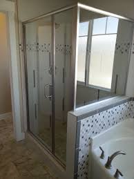 semi frameless shower enclosure done by tanner glass and hardware