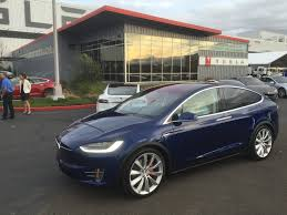 electric vehicles tesla tesla delivers 17 400 electric vehicles in q4 more than 50 000