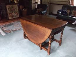 large gate leg table and chairs made of oak in neath neath