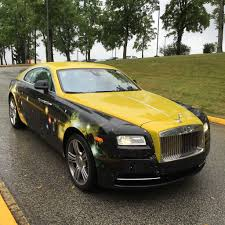 gold rolls royce antonio brown arrives at steelerscamp in a custom made black and