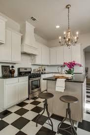 Floor Kitchen Cabinets Live Oak Creek Model Kitchen Black And White Tiled Floor Kitchen