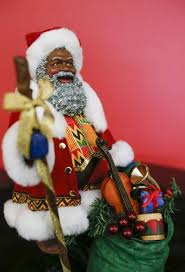 black santa collection on display in cedar rapids the gazette