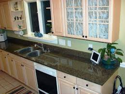White Cabinets Brown Granite by Tropic Brown Granite Countertops Granite Charlotte Countertops
