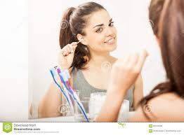 woman cleaning her ears with cotton swabs stock photo image