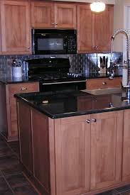 what color of backsplash with cabinets black granite kitchen countertops design ideas countertopsnews
