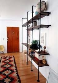 Industrial Looking Bookshelves by Diy Mounted Shelving Shelves Shelving And Apartments