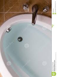 oval bathtub full of clean water ready for a bath stock photo