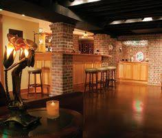 exposed basement ceiling painted cream color dark pipes i like